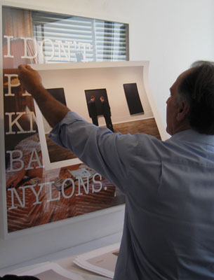 Paul Kopeikin showing prints from Andy Freeberg's series, Art Fare.