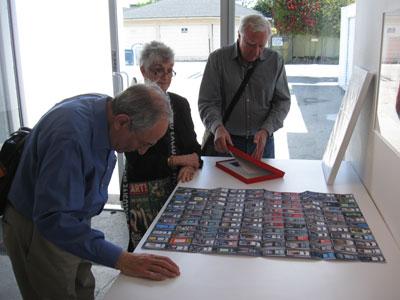 Members of INFOCUS examining Alejandro Cartagena's Carpoolers.